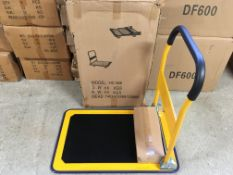 BOXED NEW PUSH/PULL YELLOW TROLLEY ON REVOLVING NYLON WHEELS