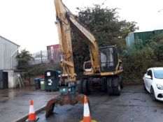 2002 Cat M312 Rubber Duck. fitted with Bucket