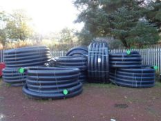 "15 X Rolls of black plastic insulated 4"" pipe"
