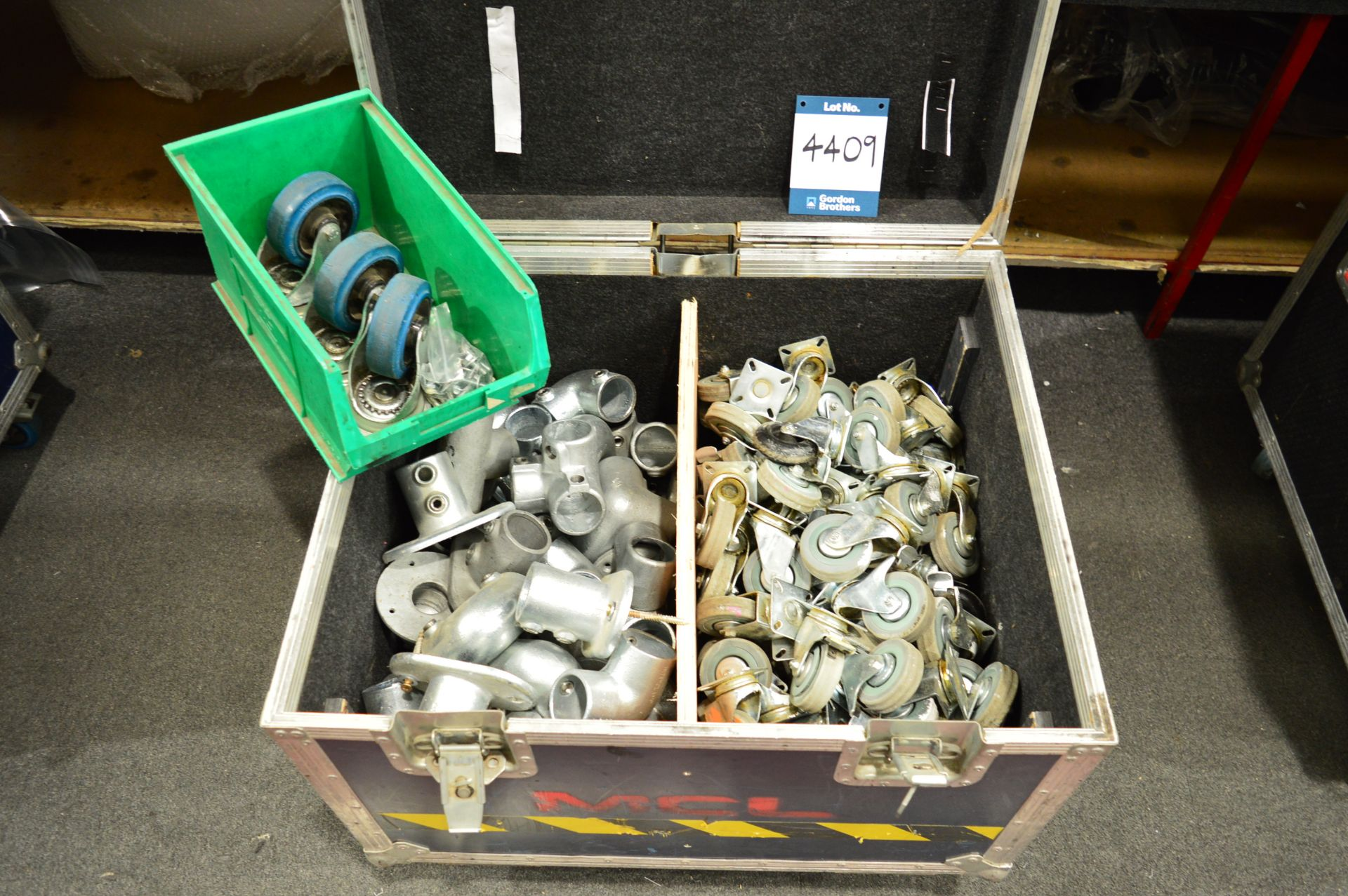 Lot 4409 - Quantity of various castor wheels and various Tube Clamp / Inter Clamp sections in flight case: Unit