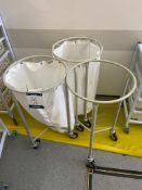 Three mobile laundry trollies
