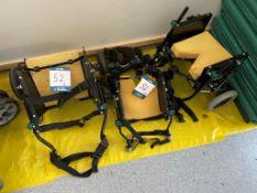 Three various canine wheelchairs