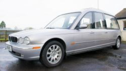 2 - Jaguar XJ6 stretch limousines and a Jaguar XJ6 hearse