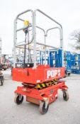 Pop-up battery electric push along scissor lift access platform Year: 2003 S/N: NSG2055 08FT0152