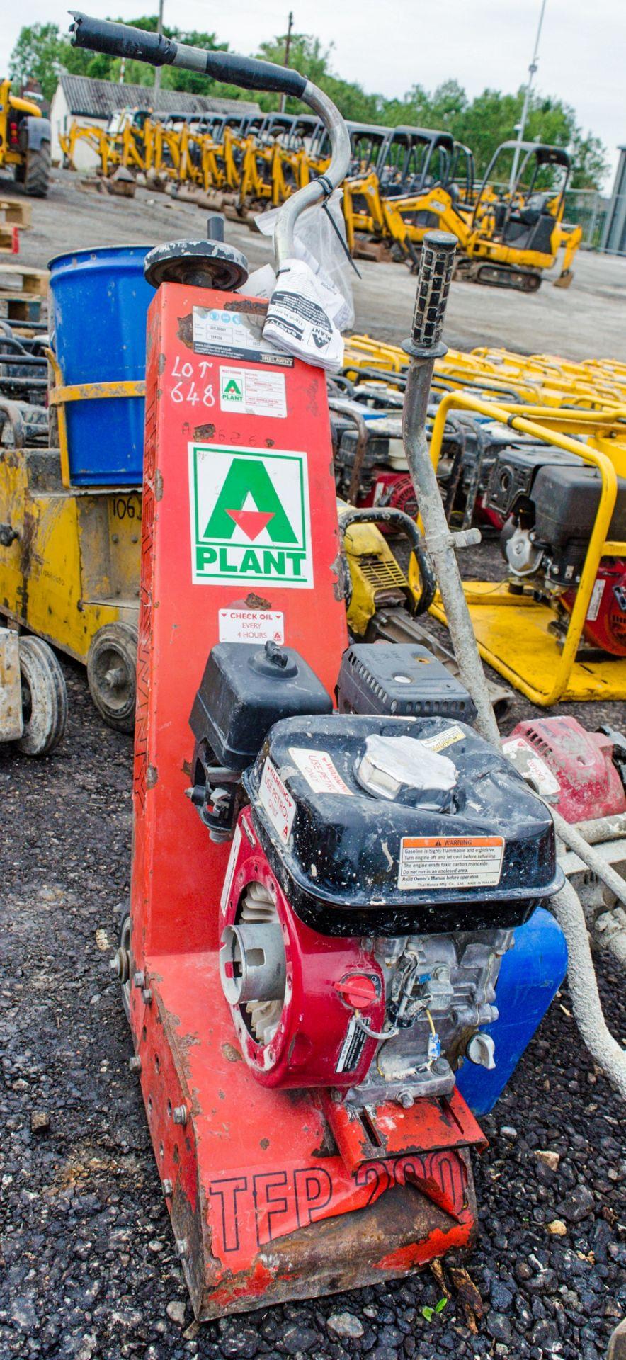 Lot 648 - Trelawny petrol driven floor planer A626260 ** Pull start missing **