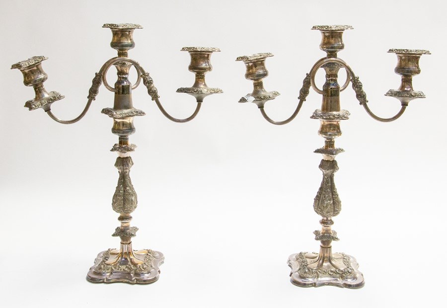 Lot 16 - A pair of plated early 20th Century three branch candelabra's