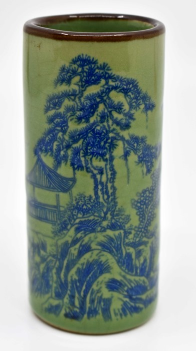 Lot 1102 - Small green ground ceramic Chinese brush pot with blue scenery decoration, signed underneath
