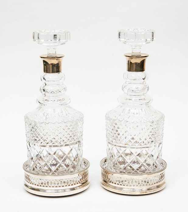 Lot 35 - Pair of silver neck, cut glass decanters with stoppers, LONDON 1980, Israel Freeman & Son Ltd and