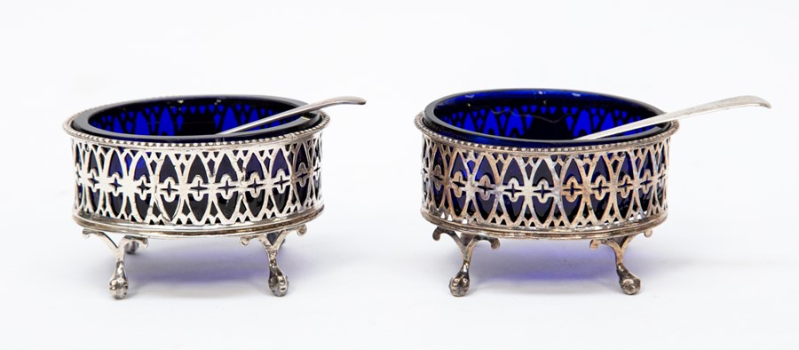 Lot 54 - A pair of Sheffield 1776 salts with liners and spoons (one George III 1789 and one Birmingham 1931),