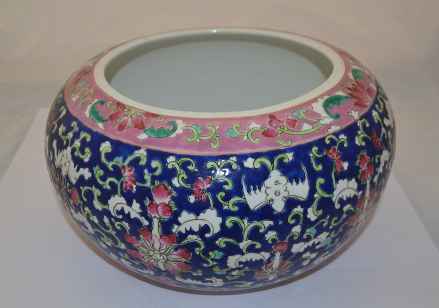Lot 2144 - A Chinese bowl, blue ground decorated with green, pink, white and turquoise floral decoration,