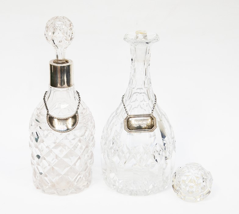 Lot 36 - Two cut glass crystal decanters, one silver rimmed both with silver drink labels, one stopper A.F