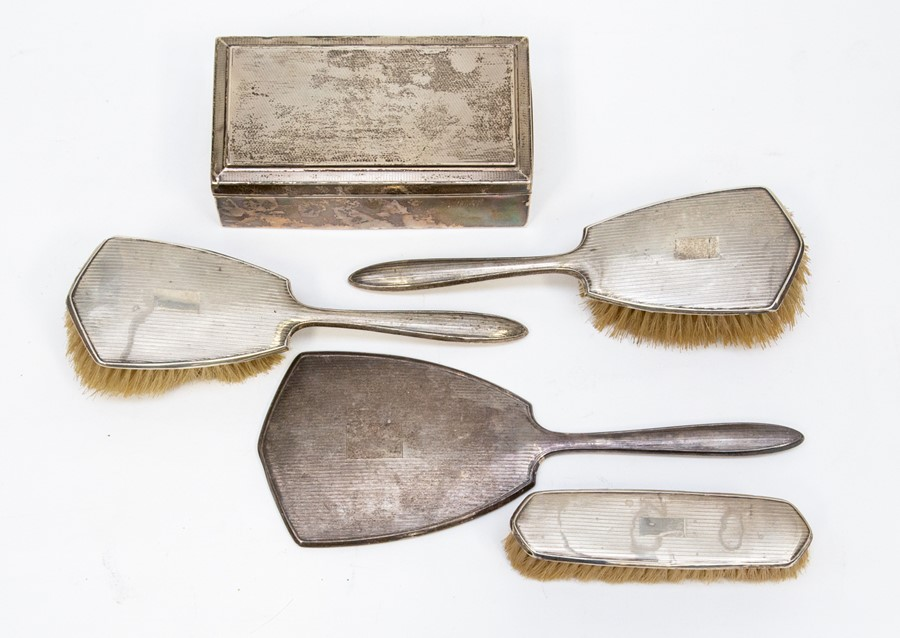 Lot 42 - A George V Art Deco silver brush set, Birmingham 1930 and 1935, comprising three brushes and a