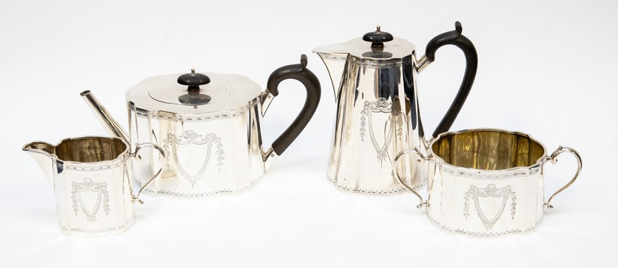 Lot 29 - A George V matched silver four piece tea service, the shaped bodies engraved with central vacant