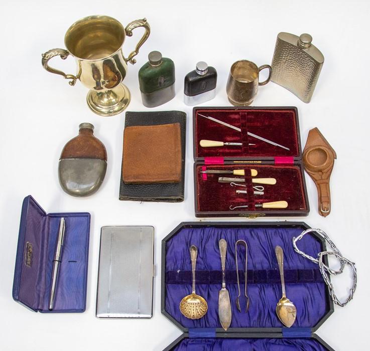 Lot 5 - An EPNS trophy; EPNS flatware; manicure set; pen; hip flasks; etc