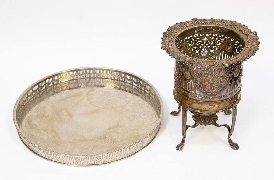 Lot 7 - An Edwardian Regency revival bottle/wine cooler together with a circular plated tray, both plated on