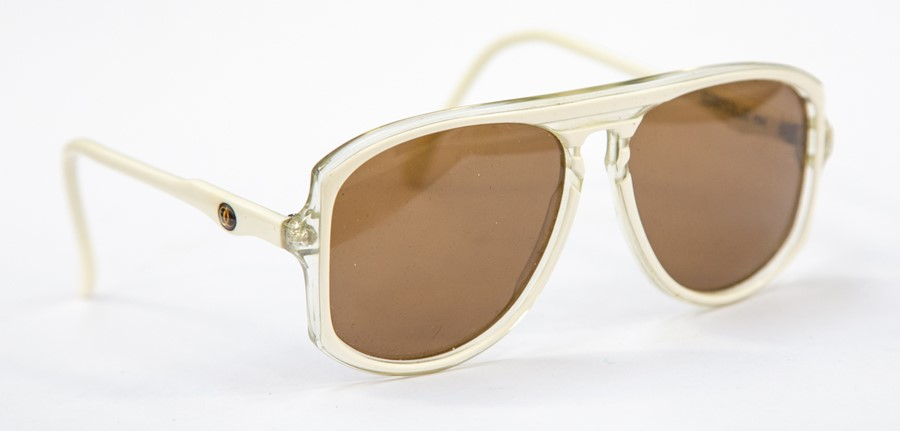 Lot 234 - A pair of designer sunglasses by Oliver Goldsmith Berwick (186, a similar pair seen to be worn by