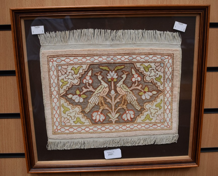 Lot 2041 - A needlework sample depicting two birds, framed 20 cms x 30 cms approx