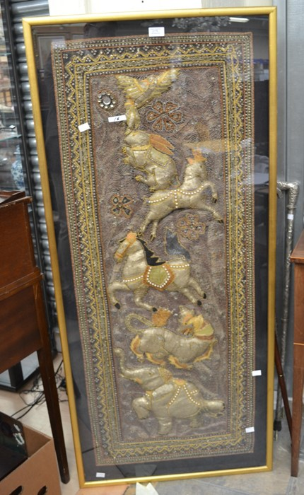 Lot 2179 - A 20th Century Burmese wall hanging, depicting animals, framed behind glass