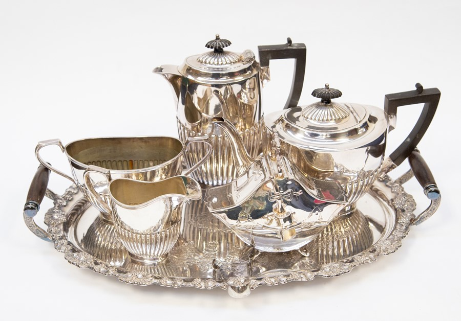 Lot 10 - Plated tray with four piece silver plated tea set and sugar caddy