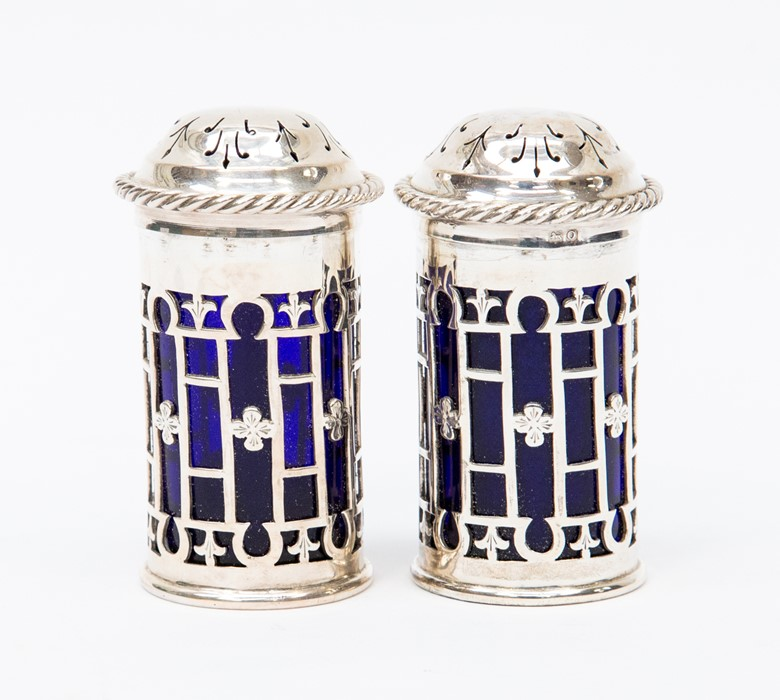 Lot 57 - A pair of Birmingham glass lined pepperettes 1913