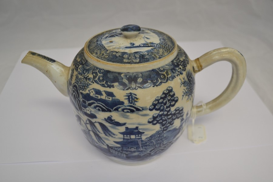 Lot 2115 - A mid 19th Century Chinese exported teapot, riveted repair to the handle blue / white Willow