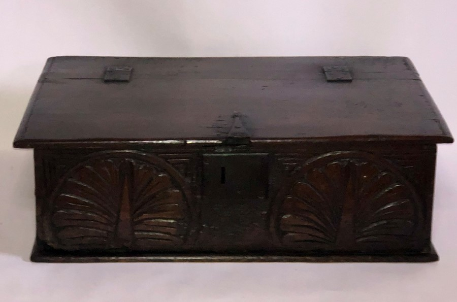 Lot 3045 - A 17th Century oak bible box, rectangular top with a hinge lid revealing spacious interior, above