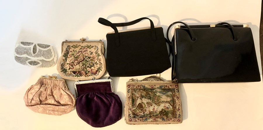 Lot 3316 - A collection of evening bags to include a 1930s cream beaded bag. Two tapestry bags one with a