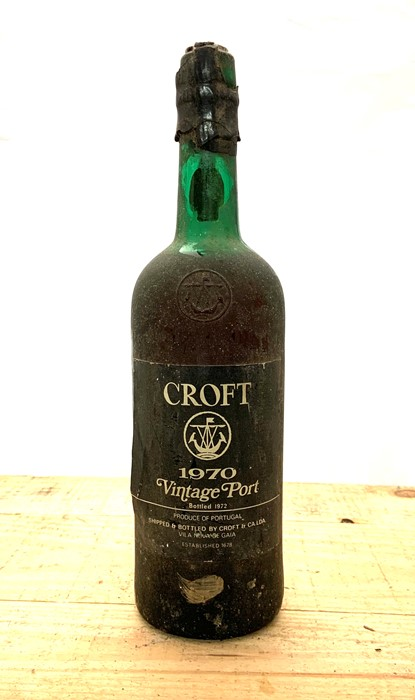 Lot 359 - A bottle of Croft 1970 Vintage port, with some damage to the seal.