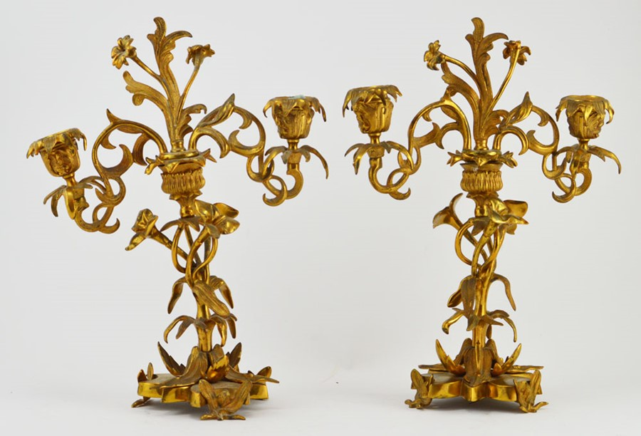 Lot 2581 - A pair of Neo-rococo gilt metal two branch candelabra, mid 19th Century, each measuring 32cm
