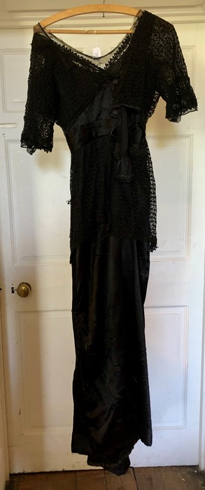 Lot 3301 - Black lace and satin early Edwardian Dress with Elbow length sleeves in lace, the bodice is of an