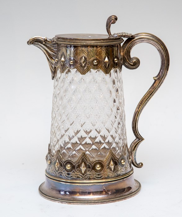 Lot 2009 - A Victorian moulded glass country house claret jug, electroplated Gothic mounts hinged cover with