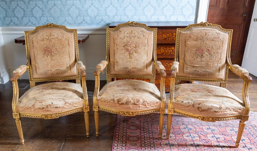 Lot 3046 - A 19th Century French piece giltwood drawing room suite, comprising a two seater settee and four