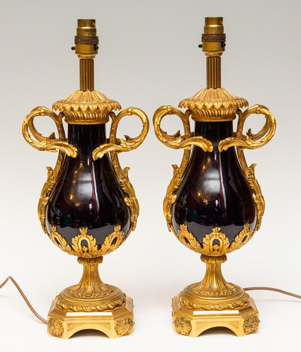 Lot 2161 - A pair of French ormolu and cobalt blue porcelain table lamps, the ormolu mounts with cast
