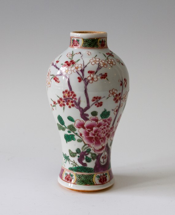 Lot 2472 - A Chinese Yongzheng porcelain baluster vase, painted with a blossom branch in polychrome enamels,
