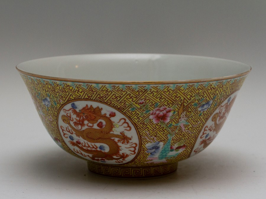 Lot 2484 - A Chinese porcelain footed bowl, the frieze painted with alternating roundels of dragons chasing