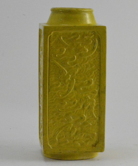 Lot 2474 - A Chinese yellow glazed porcelain Cong vase, decorated in relief with bats, the base with Qianlong