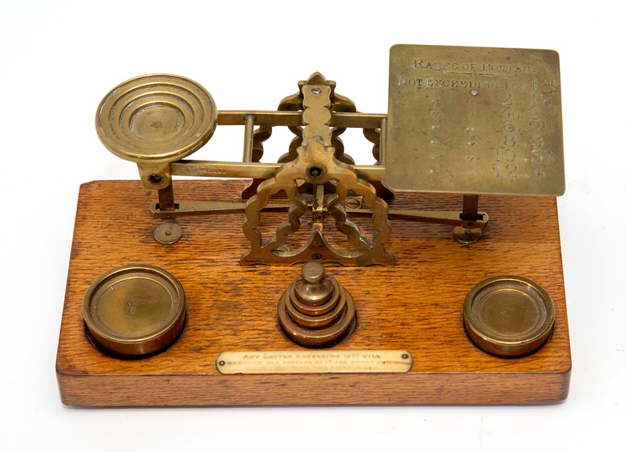 Lot 2526 - An Edwardian set of brass Sampson Mordan & Co postal scales, with six graduated brass weights on
