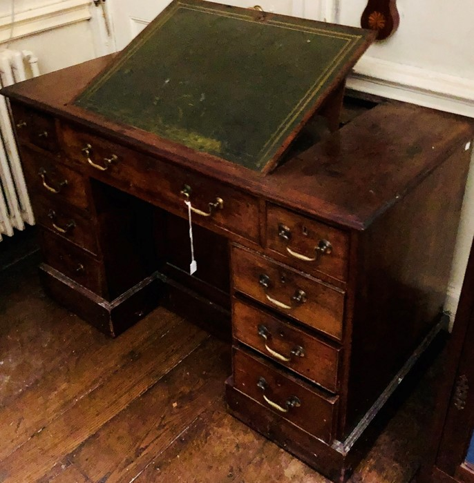 Lot 3029 - A George III mahogany kneehole writing desk, circa 1800,the centre with a leathered adjustable