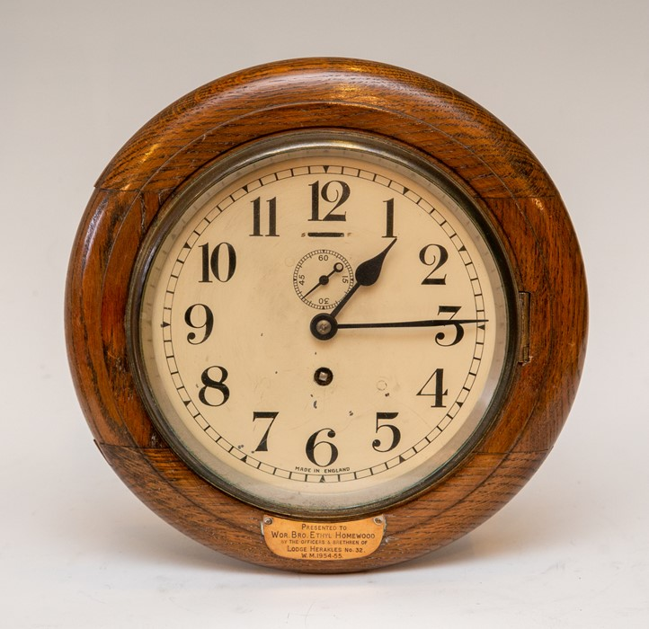 Lot 3005 - A twentieth century oak wall clock of Masonic interest, circa 1950. Beneath the face, an inscription