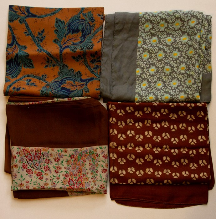 Lot 3328 - Four 1940/50's ladies designer silk scarves by Ascher, in various colours and designs - paisley/