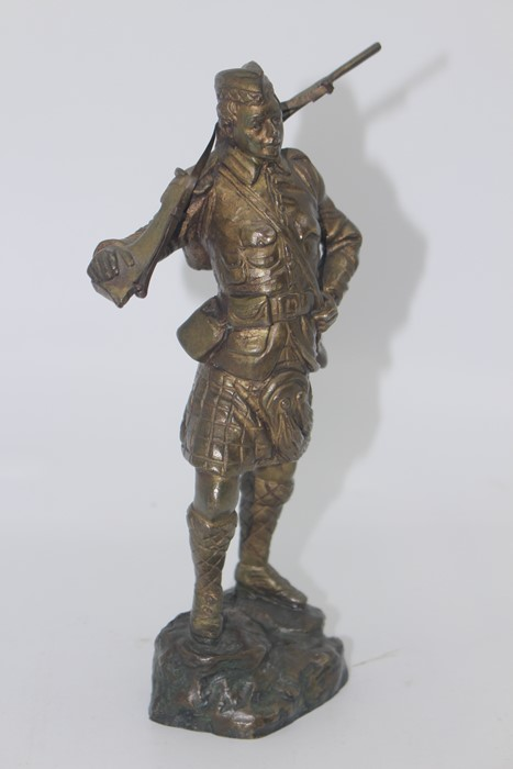 Lot 2502 - Georges Omerth (act.1895-1925), a bronze study of a WWI Scottish Soldier holding a rifle over his