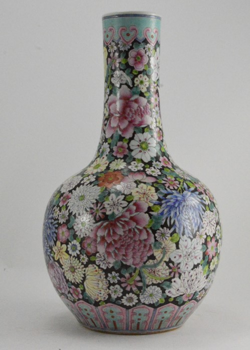 Lot 2475 - A 20th Century Chinese bottle vase, decorated in the famille rose palette with chrysanthemum and