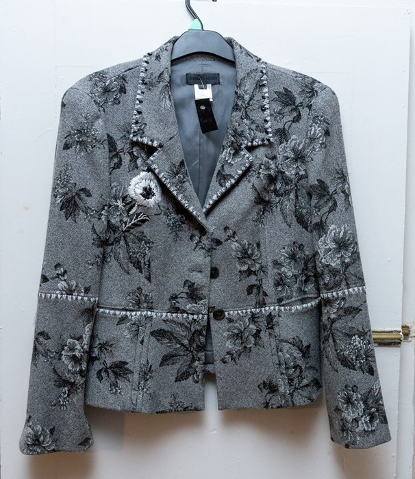 Lot 3331 - A grey mixed wool jacket with a decorative floral pattern, in grey and black and an embroidered