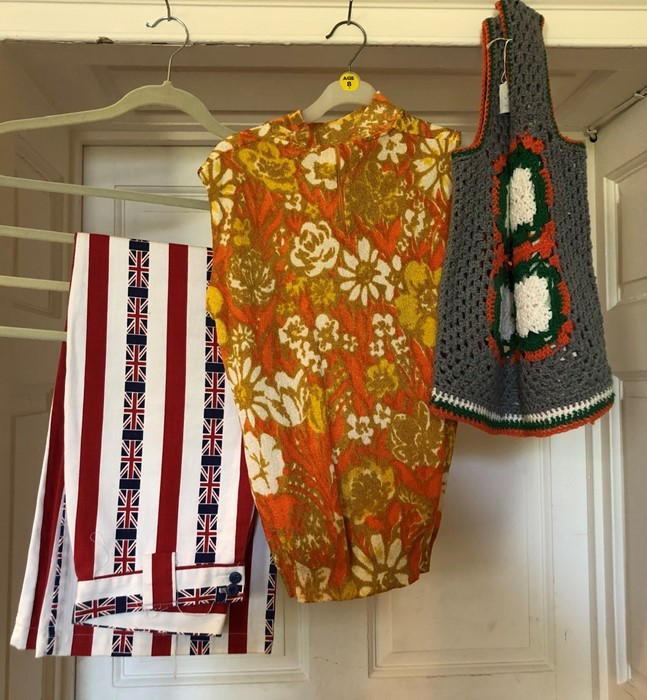 Lot 3325 - A circa 1960's crochet tank top with crochet colourful panel and an orange patterned short top, high