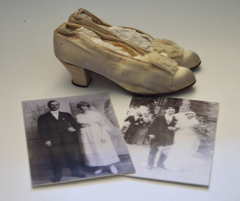 Lot 3315 - A Canadian wedding dress from 1918 together with wedding shoes. The dress is pure silk and made up