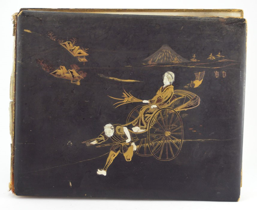 Lot 2495 - A Japanese lacquer album of photographs, Meiji Period, of domestic life