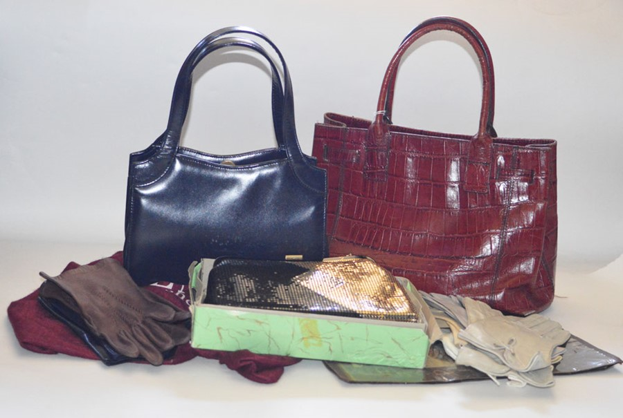 Lot 3312 - A Dents Navy Bag, 2 handles 1990s with suede lining. A burgundy coloured crocodile handbag with