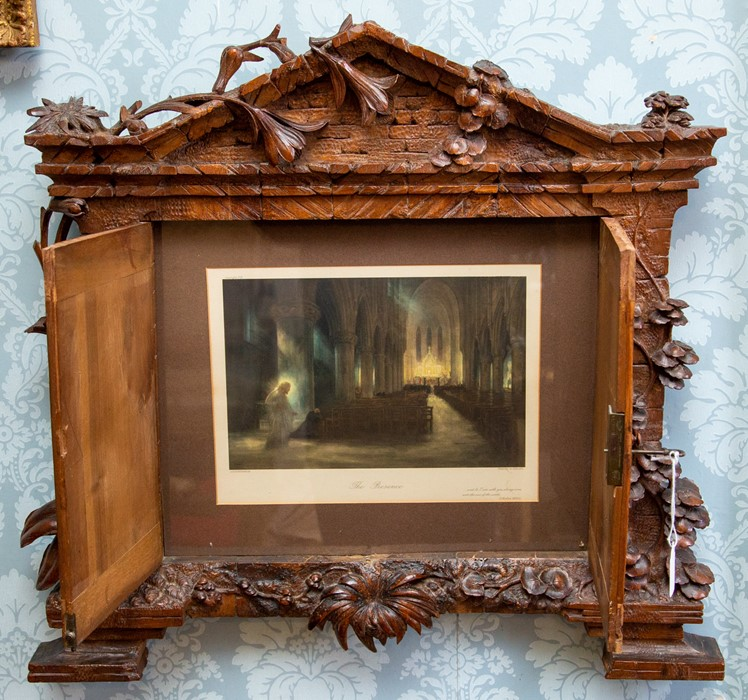 Lot 2521 - A late 19th Century Black Forest carved wooden wall mounted frame, circa 1880, of architectural form