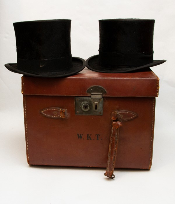 Lot 3310 - An early 20th Century tan leather double top hat box, containing two black silk Woodrow top hats