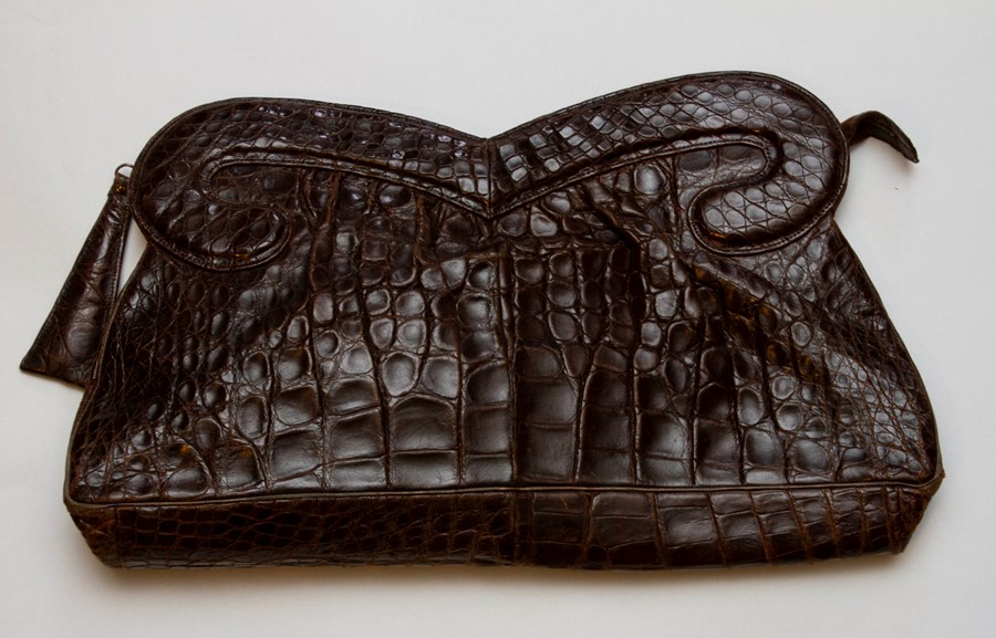 Lot 3308 - A Brown Crocodile Clutch bag in a large design, late 1940s with a metal zip disguised fastening. The